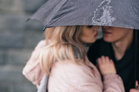 A couple hugging under an umbrella closeup 2 - free stock photo