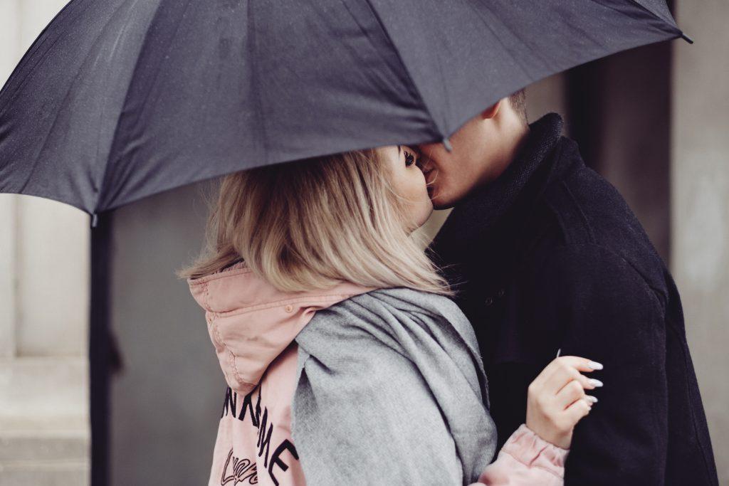 A couple kissing under an umbrella 2 - free stock photo