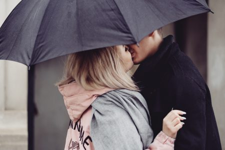 A couple kissing under an umbrella 2 - free stock photo