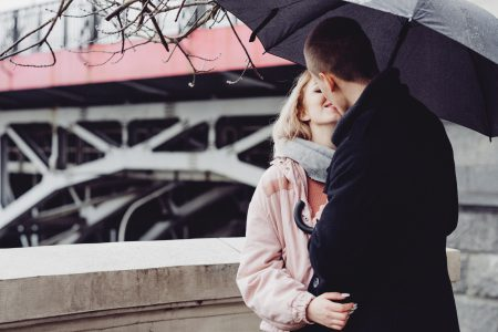 A couple kissing under an umbrella 3 - free stock photo