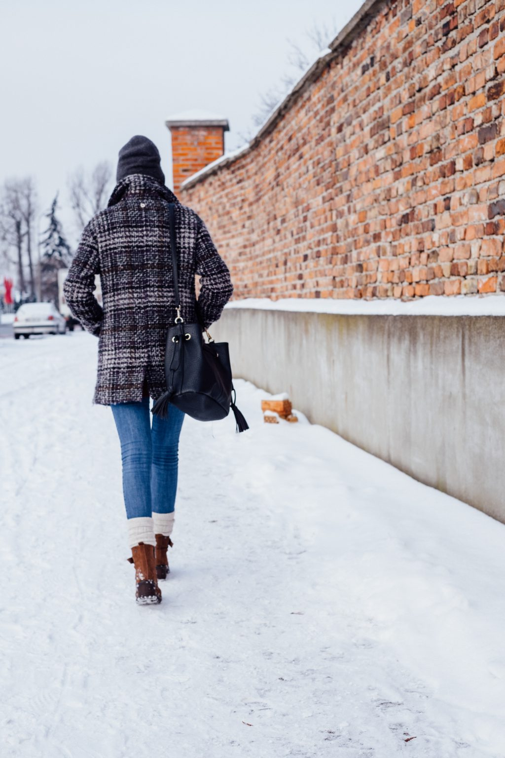 A female walking on a snow-covered pavement 2 - free stock photo