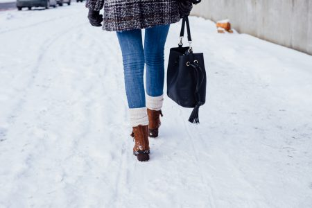A female walking on a snow-covered pavement 3 - free stock photo