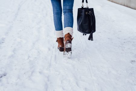 A female walking on a snow-covered pavement 4 - free stock photo