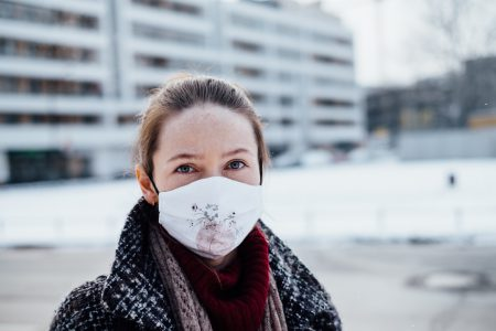 A female wearing a protective face mask - free stock photo