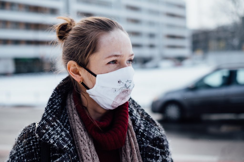 A female wearing a protective face mask 2 - free stock photo
