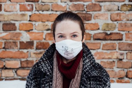 A female wearing a protective face mask 3 - free stock photo