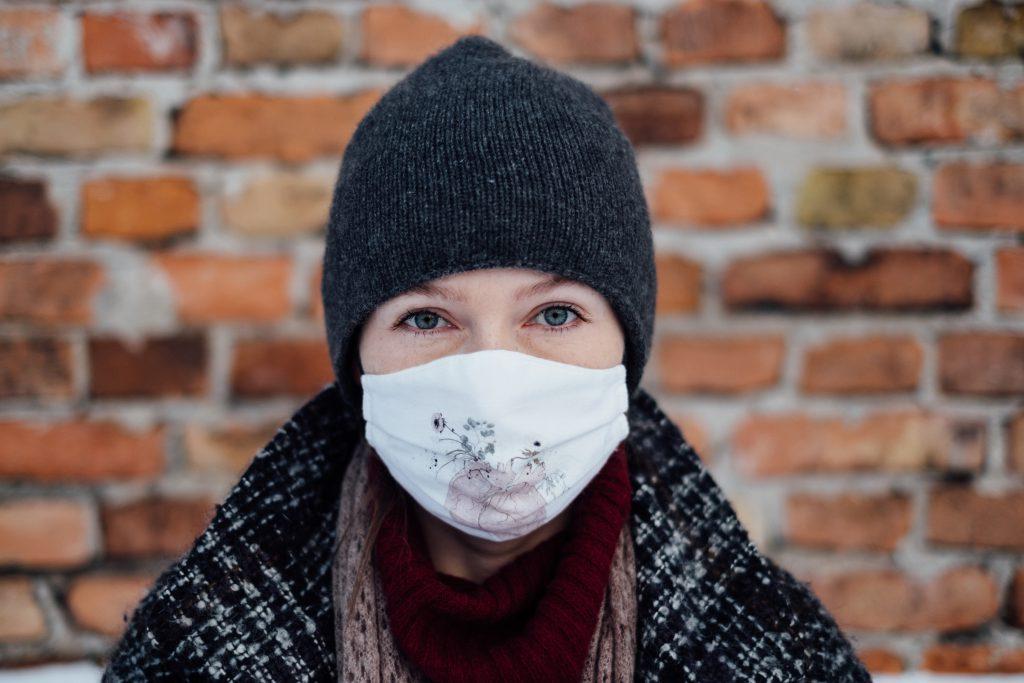 A female wearing a protective face mask 4 - free stock photo