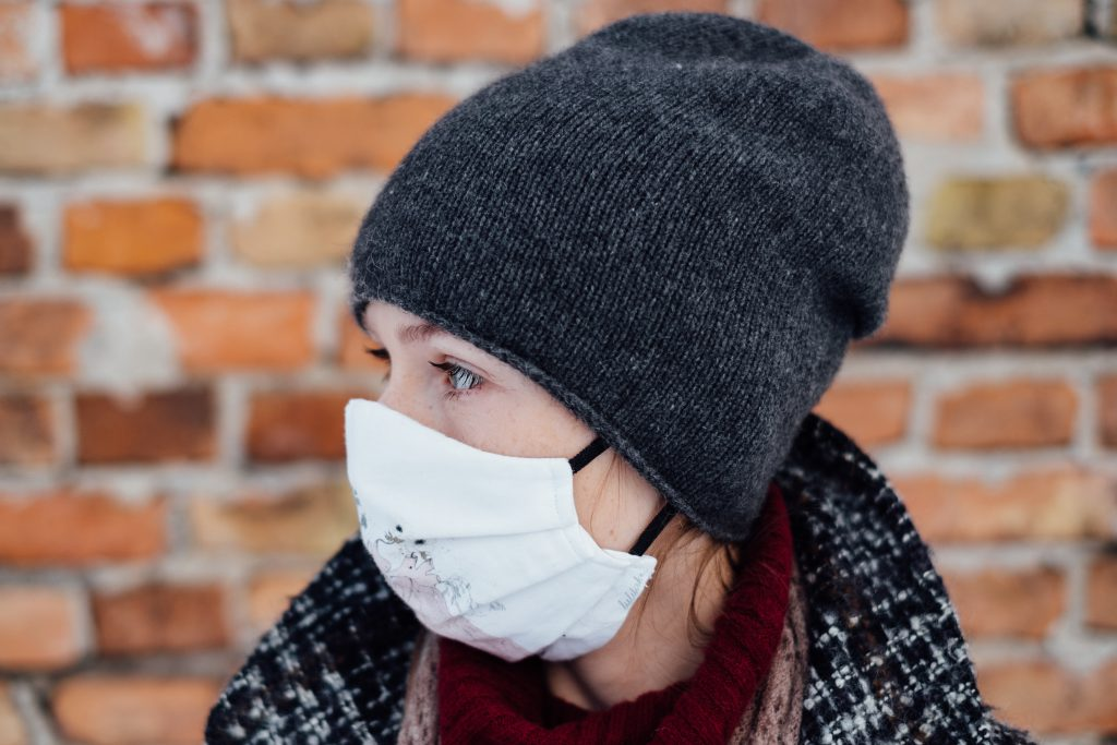 A female wearing a protective face mask closeup - free stock photo