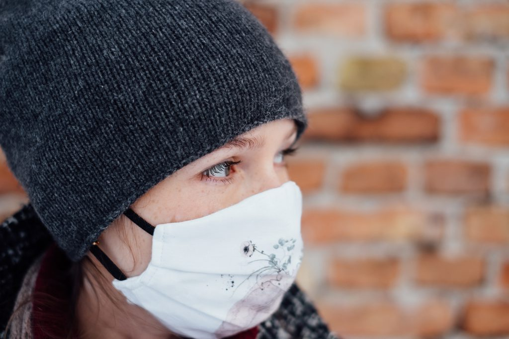 A female wearing a protective face mask closeup 2 - free stock photo