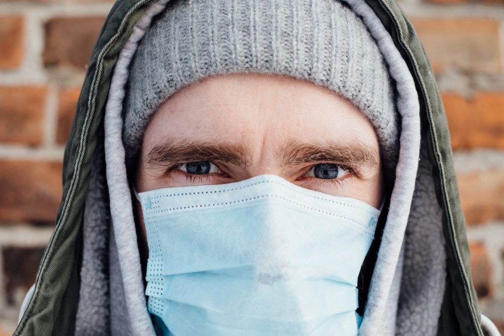 A male wearing a protective face mask closeup 2 - free stock photo
