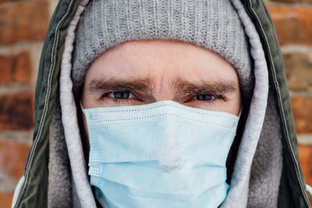 A male wearing a protective face mask closeup 3 - free stock photo