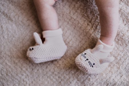 Bunny slippers on newborn's feet - free stock photo
