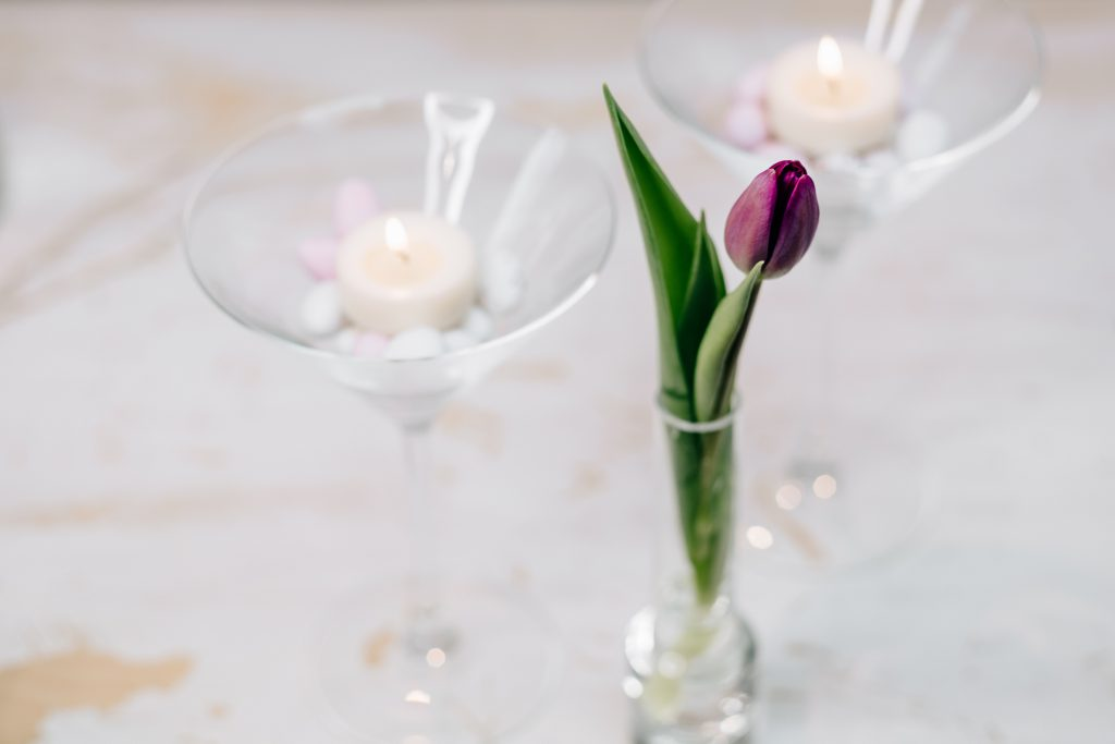 Table candle decoration with a purple tulip - free stock photo