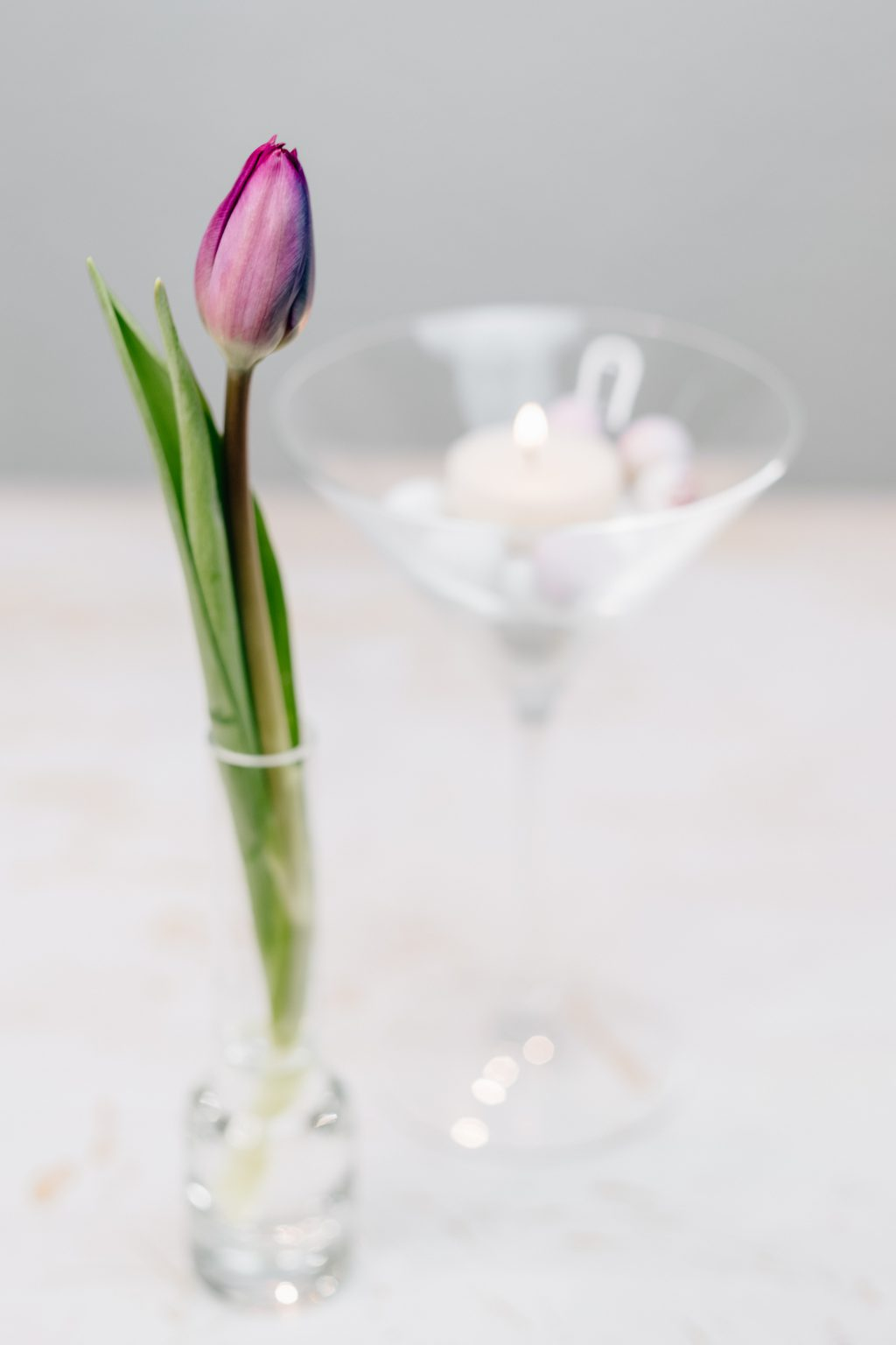 Table candle decoration with a purple tulip 2 - free stock photo