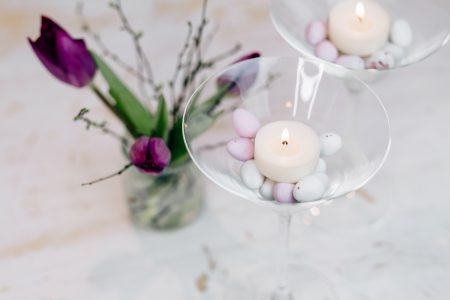 Table candle decoration with purple tulips - free stock photo