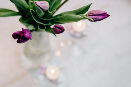 Table candle decoration with purple tulips 3 - free stock photo