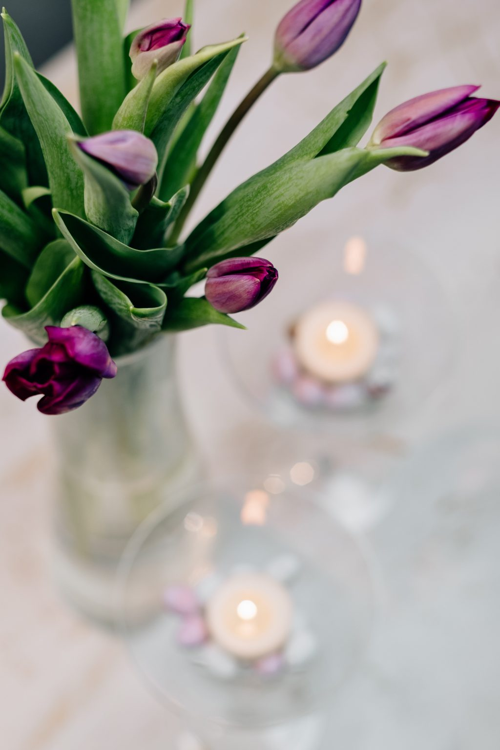 Table candle decoration with purple tulips 4 - free stock photo