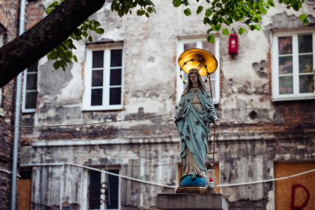 Catholic holy figure worship place outside a poor neighbourhood building 3 - free stock photo
