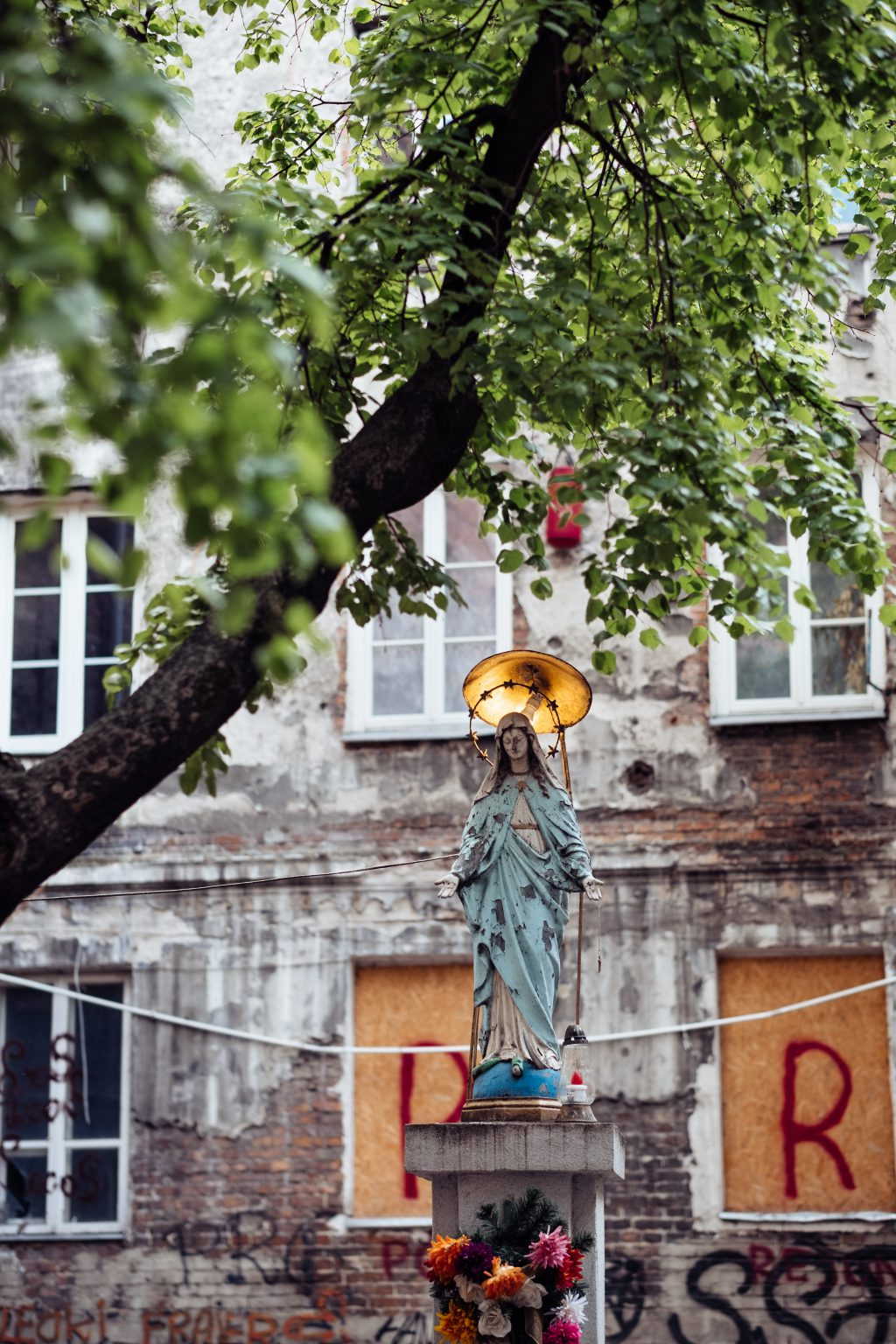 Catholic holy figure worship place outside a poor neighbourhood building 4 - free stock photo