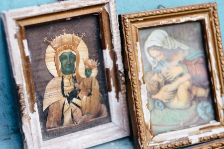 Distressed catholic holy pictures placed outside a poor neighbourhood closeup - free stock photo