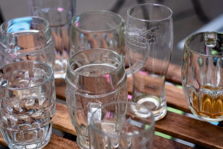 Empty beer glasses on an outdoor table - free stock photo