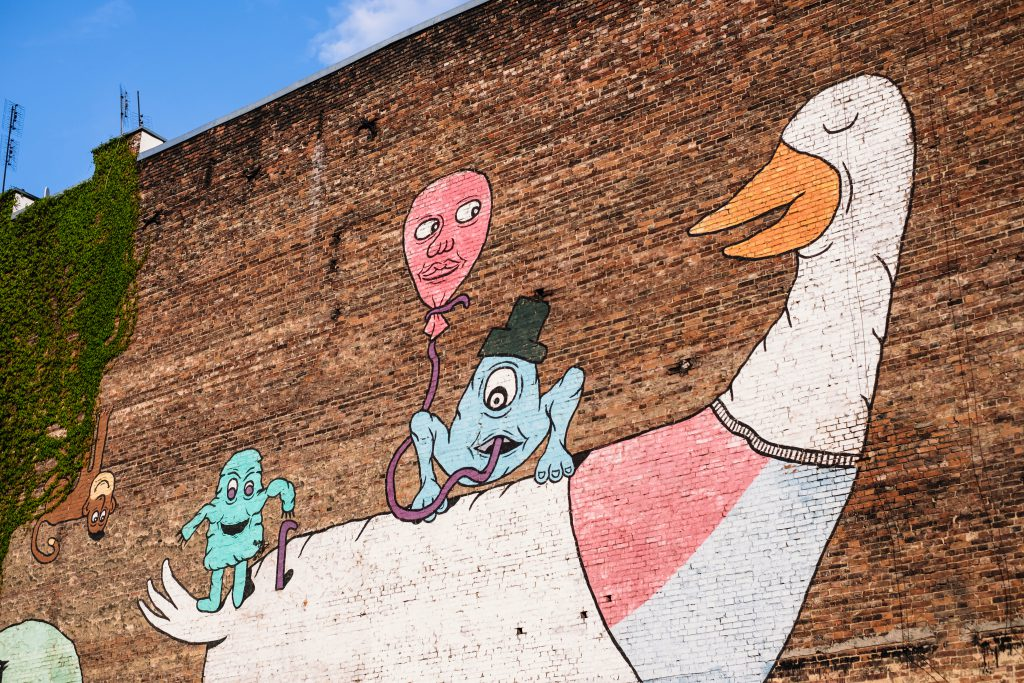 Graffiti of a cartoon duck on a brick wall - free stock photo