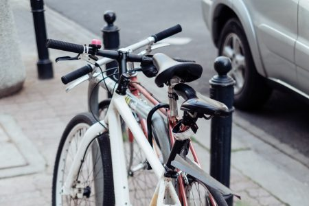 Bicycles attached to a bike rack - free stock photo