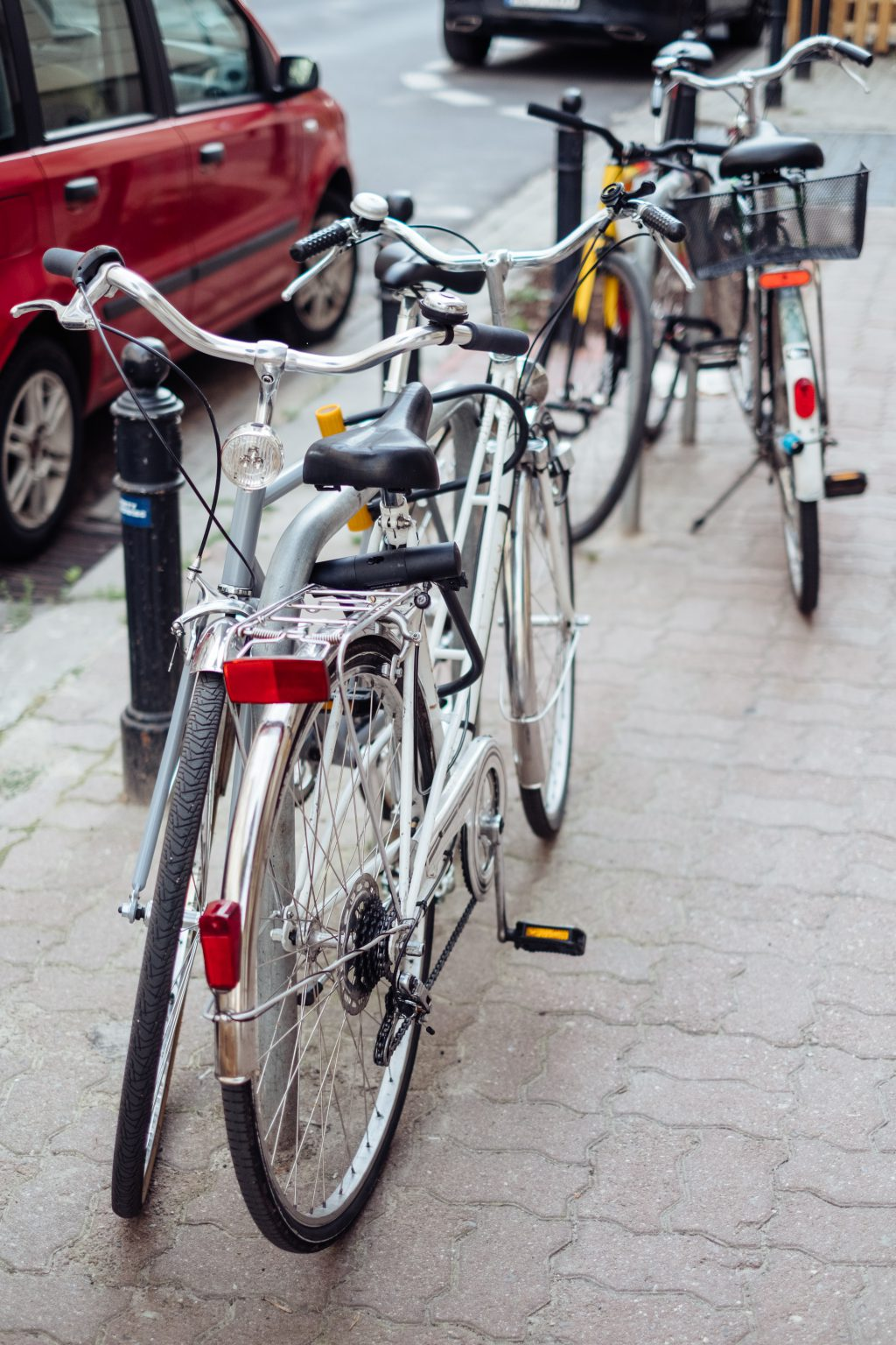 Bicycles attached to bike racks - free stock photo
