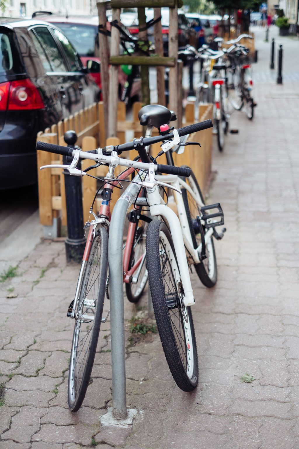 Bicycles attached to bike racks 2 - free stock photo