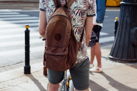 Cyclist and a pedestrian waiting at the road zebra crossing - free stock photo