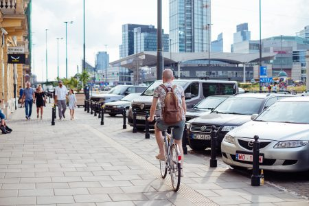 Cyclist riding along the sidewalk - free stock photo