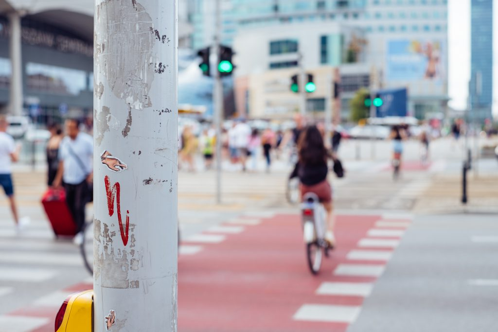 Cyclists and pedestrians crossing the road - free stock photo