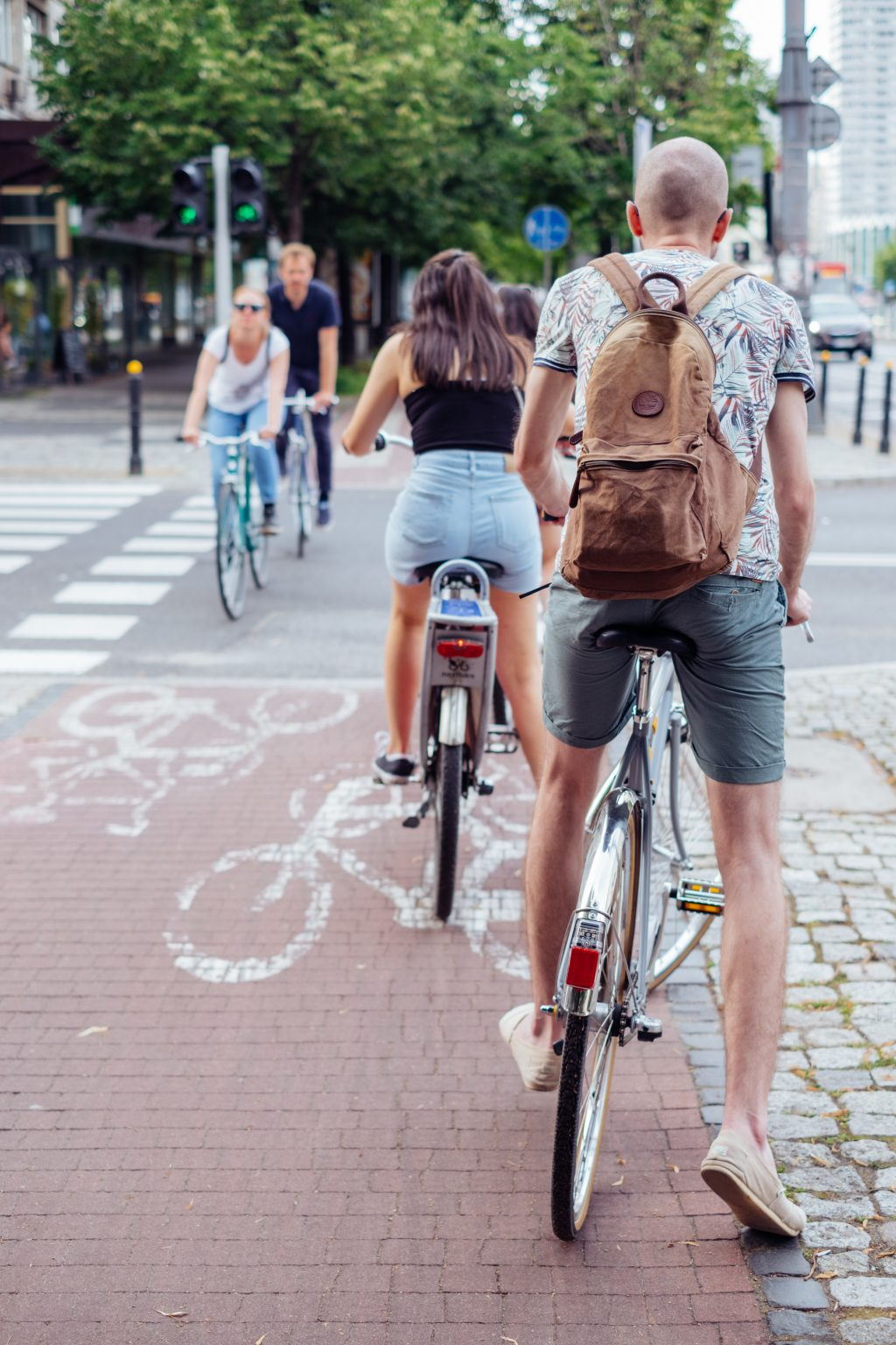 Cyclists crossing the road - free stock photo