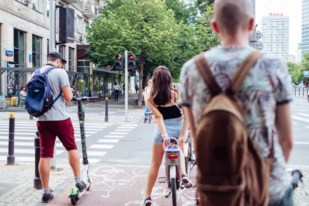 Cyclists waiting for a green light at the road zebra crossing 2 - free stock photo