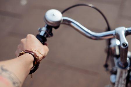 Female hand holding a bicycle handlebar - free stock photo