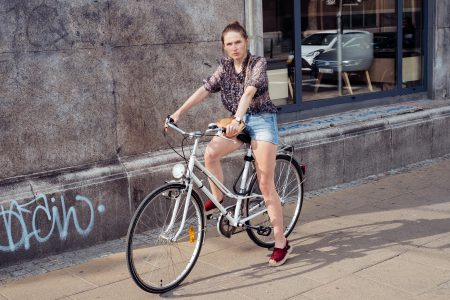 Female on a bicycle in the city - free stock photo