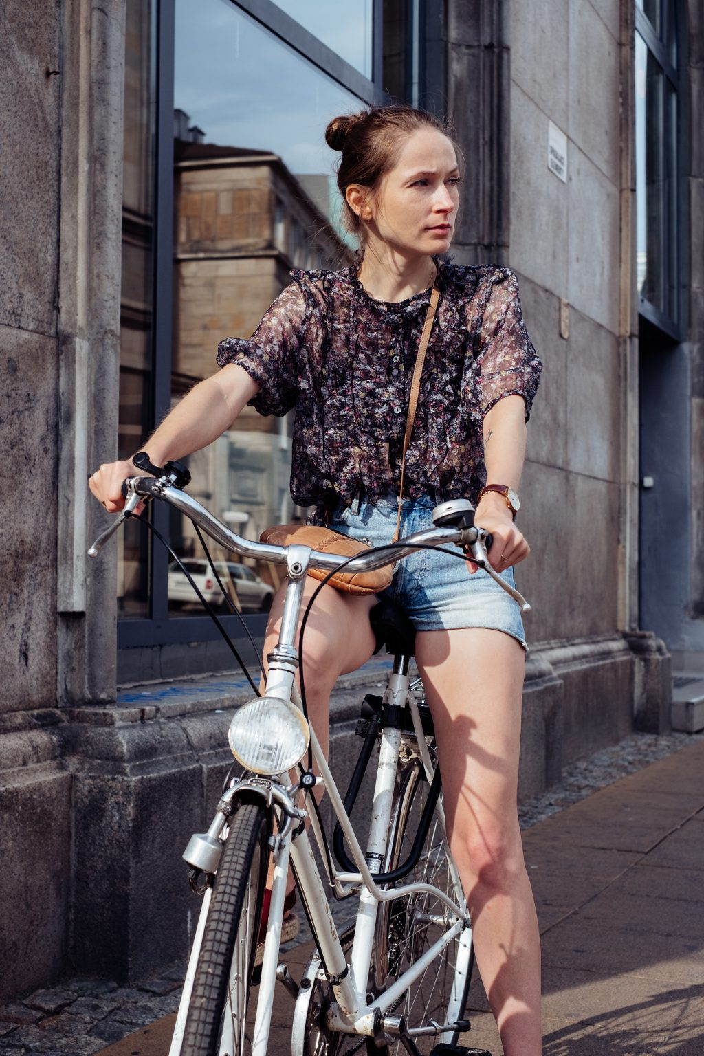 Female on a bicycle in the city 3 - free stock photo