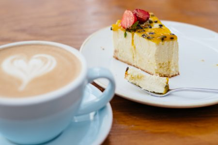 Latte and a cheesecake on a café table 2 - free stock photo