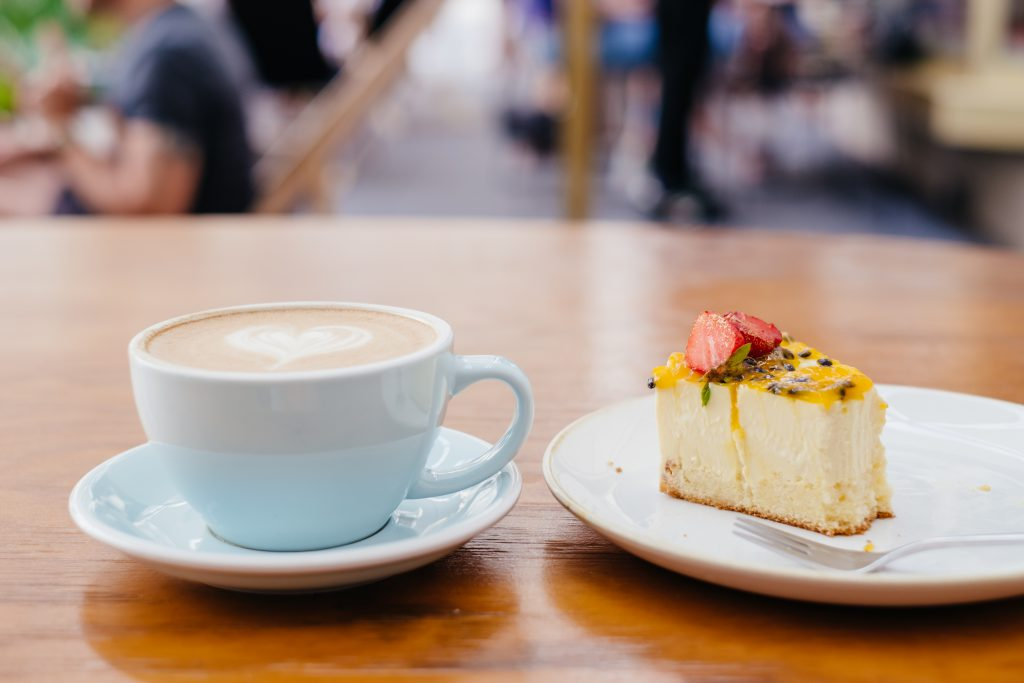 Latte and a cheesecake on a café table 3 - free stock photo