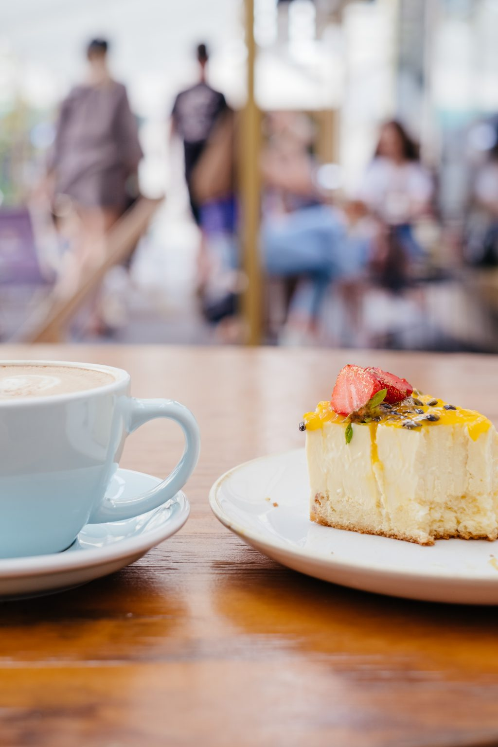 Latte and a cheesecake on a café table 4 - free stock photo