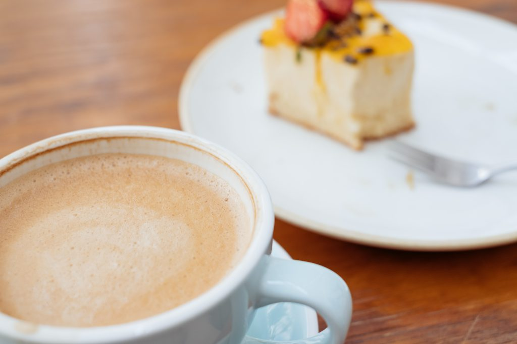 Latte and a cheesecake on a café table 5 - free stock photo