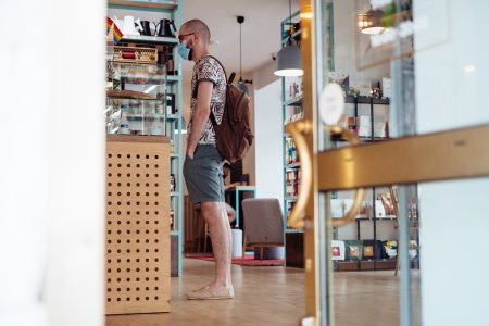 Male customer waiting at the counter in a café - free stock photo