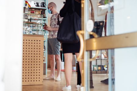 Male customer waiting at the counter in a café 2 - free stock photo