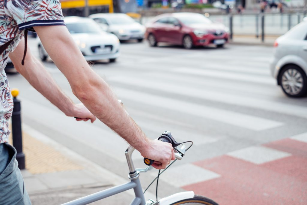 Male cyclist waiting for a green light at the road crossing 2 - free stock photo