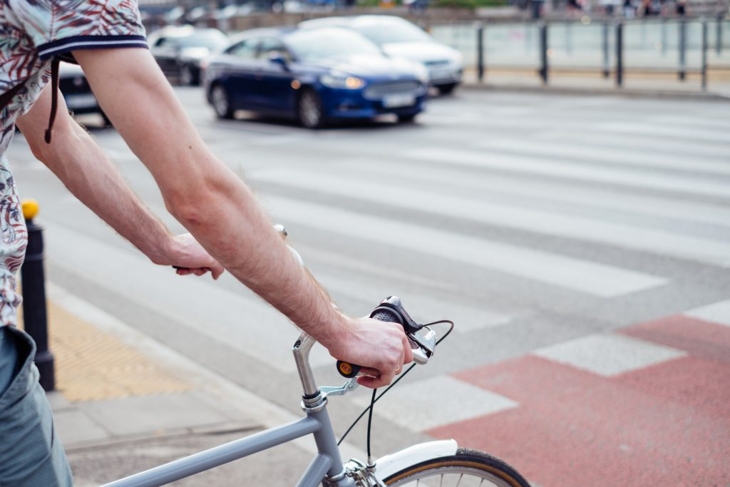 Male cyclist waiting for a green light at the road crossing 3 - free stock photo