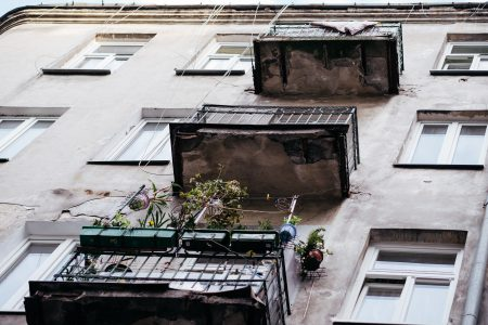 Balconies on a neglected building - free stock photo