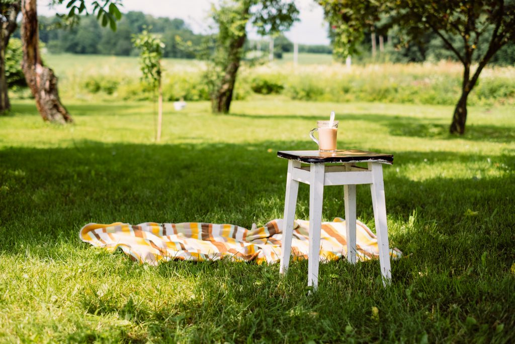Cup of coffee on a vintage stool outdoors - free stock photo
