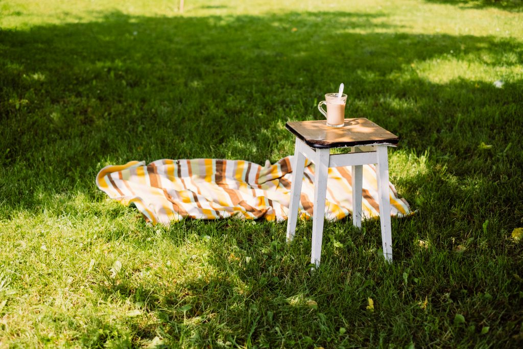 Cup of coffee on a vintage stool outdoors 2 - free stock photo