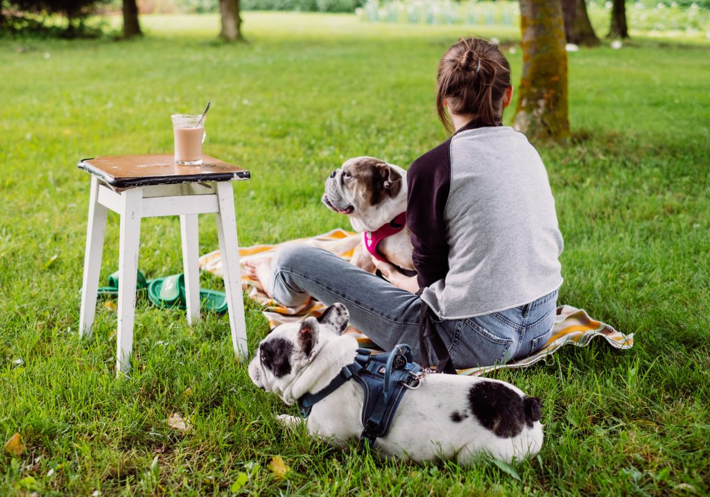 Female having a coffee outdoors with dogs 2 - free stock photo