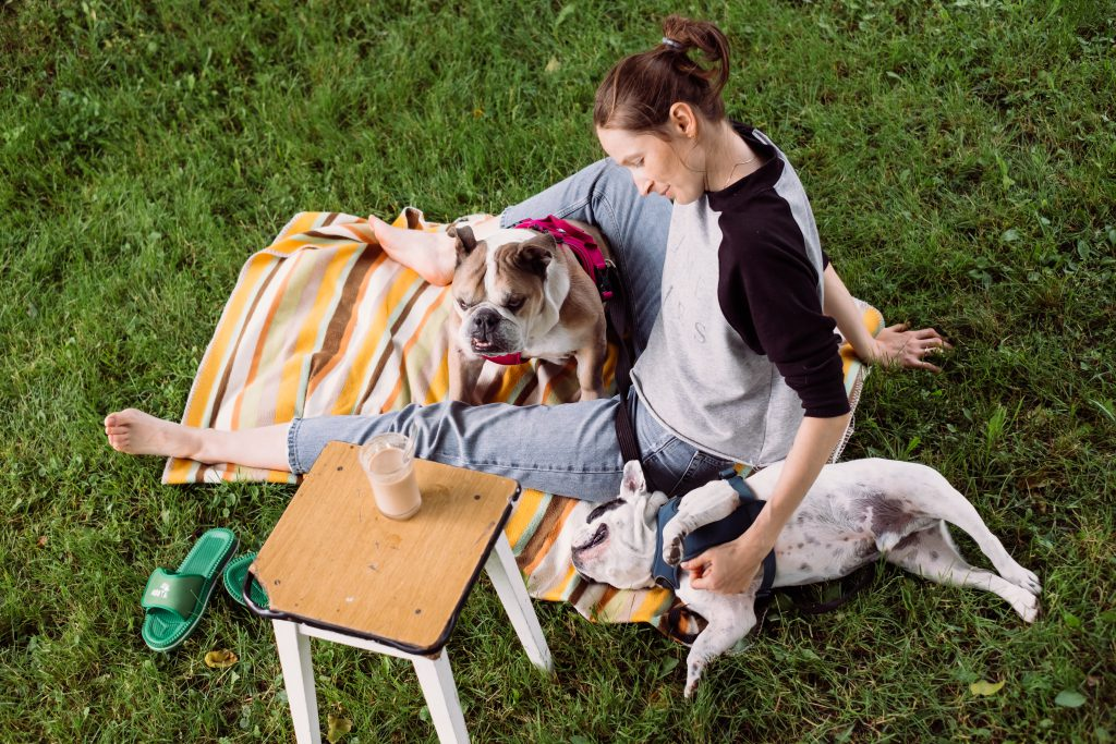 Female having a coffee outdoors with dogs 3 - free stock photo